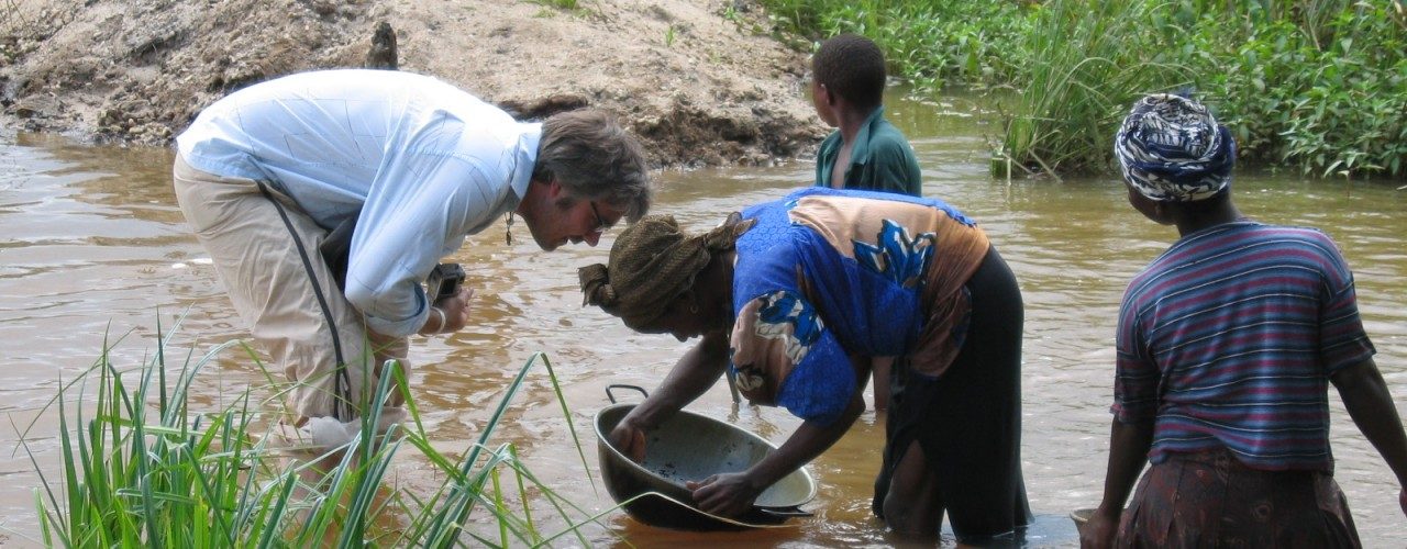 Artisanal woman mining gold in a diamond tailings pond - Sierra Leone 2005